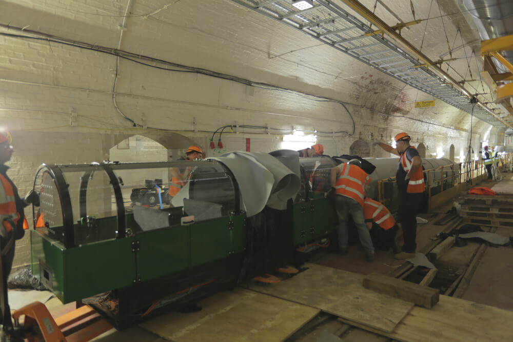 Carriage being installed on tracks underground at the Postal Museum