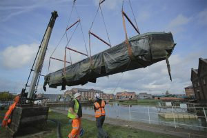 An historic inland waterways craft lifted from the water at the Canal & River Trust's National Waterways Museum near Ellesmere Port